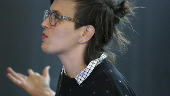 a woman with in profile with glasses and brown hair