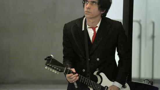 man with guitar, a red necktie and double breasted suit