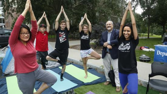 Men and woman doing yoga outside