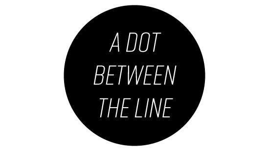 A black circle with the words 'A Dog Between the Line' written in it.