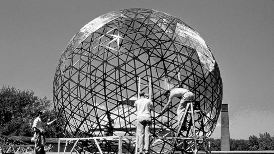 Black and white photo of men working on the Buckey Ball