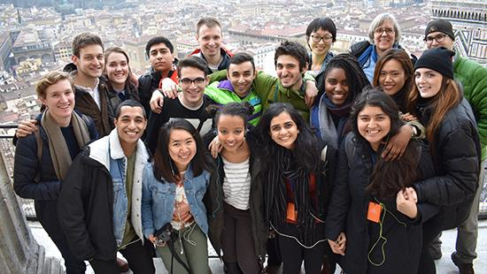 A group of students with the city of Florence, Italy, in the background