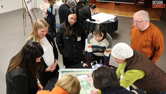 a group of people gathered around a map on a table
