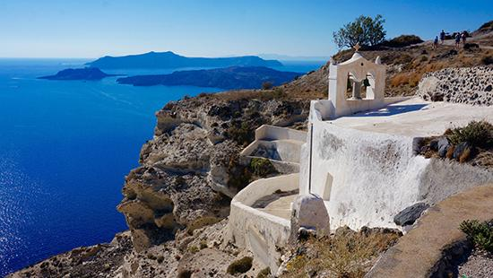 a white building on Santorini, Greece, overlooking the ocean