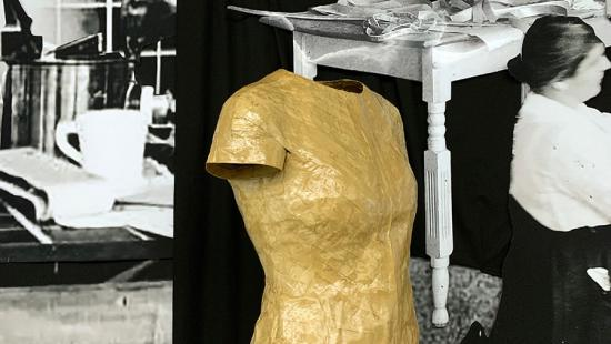 Gummed-tape dress form and historical photographs.