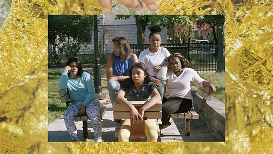 Gold foiled frame around a photo of five young women sitting at a picnic table.