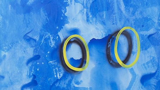 Painted background of different blue hues with two yellow oblong circles in the middle right casting a darker oval shadow.