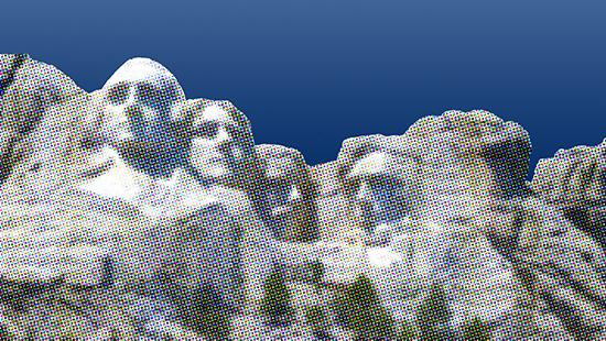 A pixelated image of Mount Rushmore set against a clear blue sky