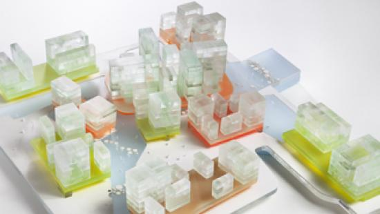 model of clear boxes on green, orange, and tan bases