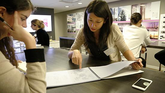 Architect reviewing portfolio with AAP student
