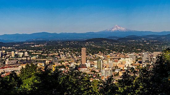 Panoramic photo of Portland, Oregon with Mt Hood in the back.