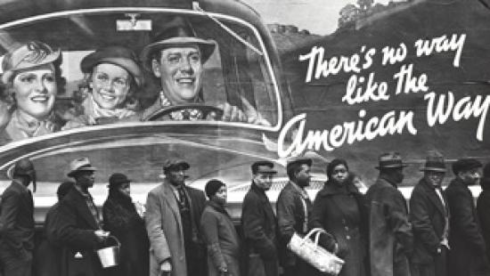 Vintage photograph of African Americans in front of a billboard with a white family in a car