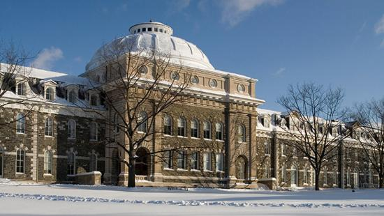 A white-domed stone building in the wintertime