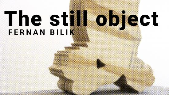 Wooden abstract figure set behind the words 'the still object fernan bilik'.