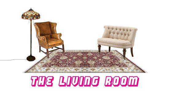 living room with a rug, two chairs, and a floor lamp