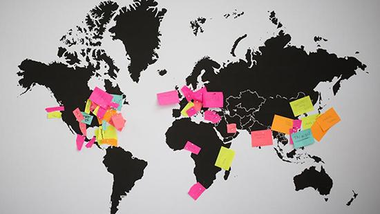 map of the world with colored post-its