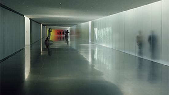 Long hallway with silhouetted figures.