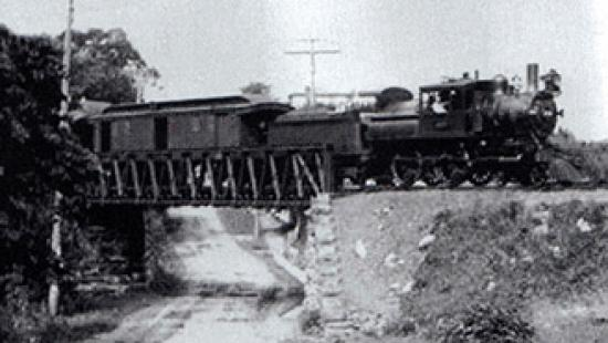 Train on old railway bridge.