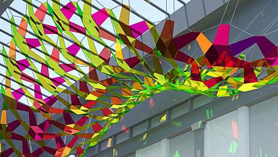 Colorful connected panels hanging from a skylight.