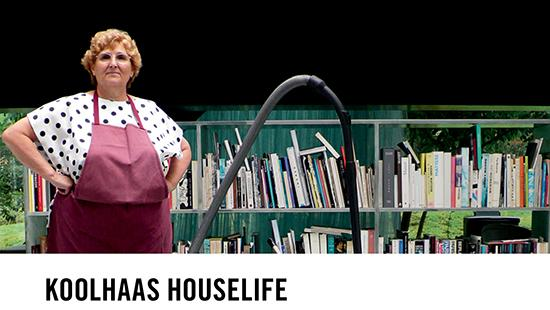 a woman in an apron standing in front of a bookshelf