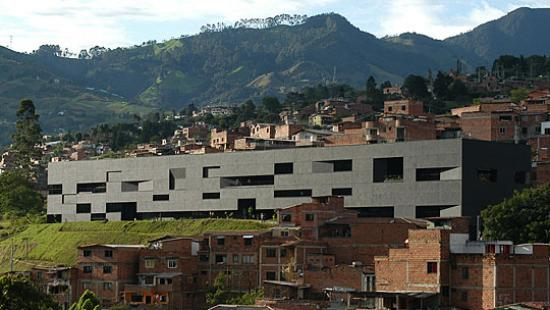 Modern building with hills in the background