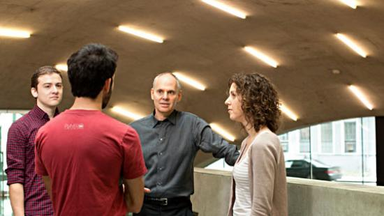 Dean Kleinman talking with students in Milstein Hall