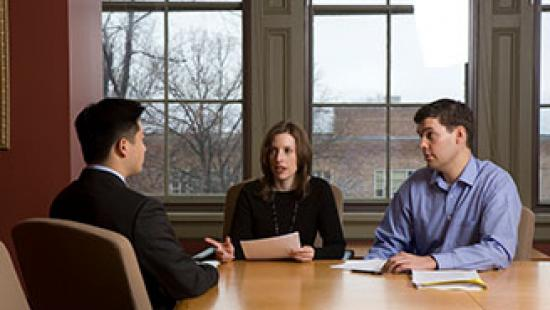 Student interviewing with two people