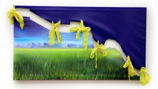 Dark blue fabric attached to a cut piece of a painting depicting a landscape, held together with bright yellow ribbons.