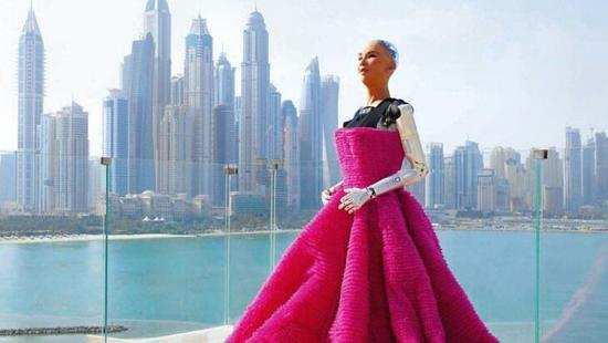 human-robot figure in a red ball gown, a river, urban skyscrapers.