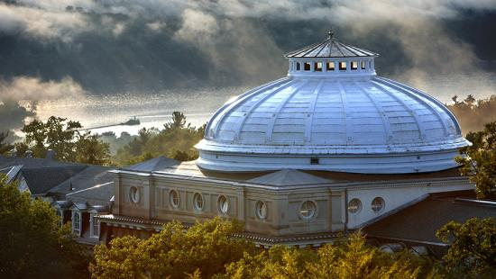 The Sibley Hall dome, with fog rolling in over Cayuga Lake. photo / Lindsay France (UREL)
