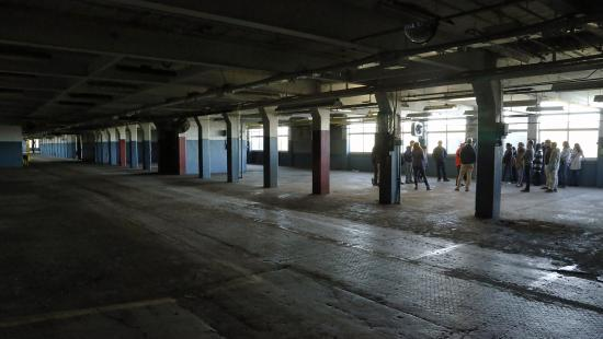 A group of students in a disused factory in Ithaca New York
