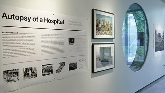 A sign with the title of the exhibition Autopsy of a Hospital on display in Milstein Hall.