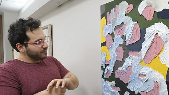 Student, Left viewing his installed painting