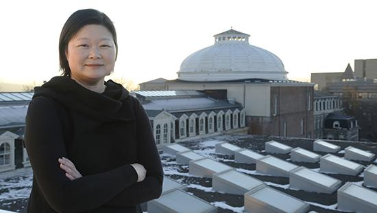J. Meejin Yoon atop Milstein Hall with Sibley Dome in the background.