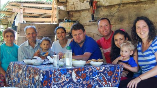 Jeffrey Wall (in red t-shirt) with his research team and family members in the Sinop Province of Turkey, enjoying a meal outside a historic home framed and sided with chestnut timber.