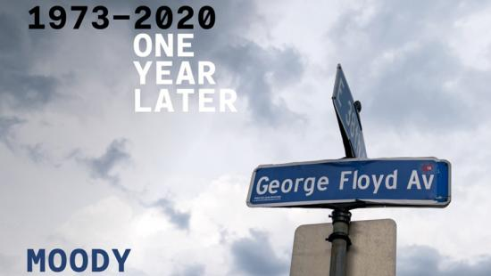 Cloudy sky, street sign, blue and white text
