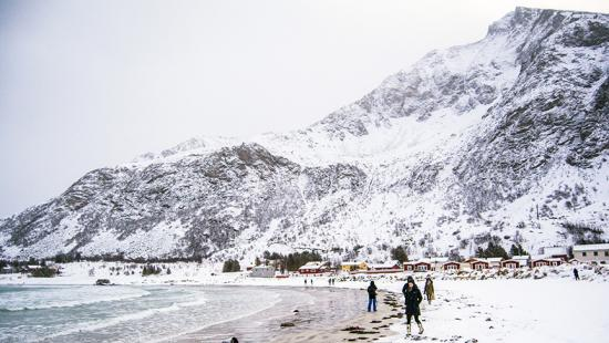 Students on a beach in Norway in winter