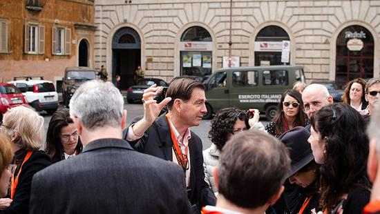 Jefferey Blanchard standing with guided tour group on a street in Rome