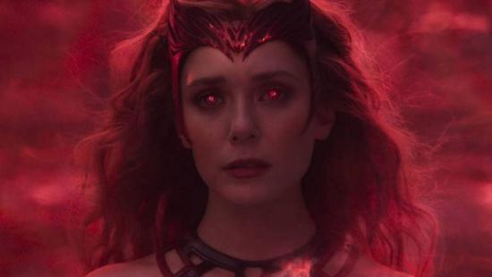 Woman wearing a red headband surrounded by red light with red clouds in the background.