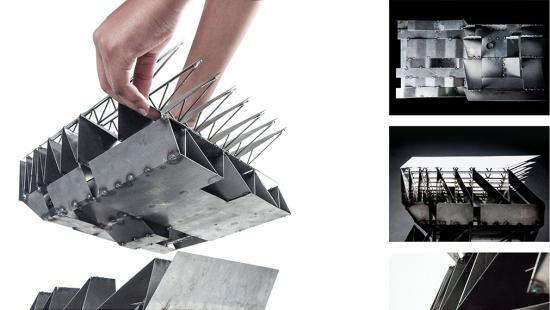 Hands lifting the top off a metal scale model of a building