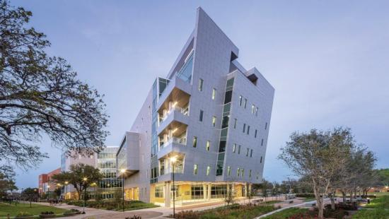 Five-story angular building made of concrete and glass.