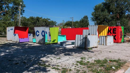 A collection of brightly colored sections of corrugated metal.