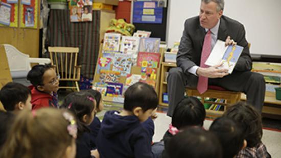 Man reading to pre-kindergarten class