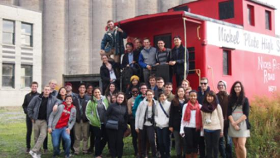 Students standing in front of red caboose
