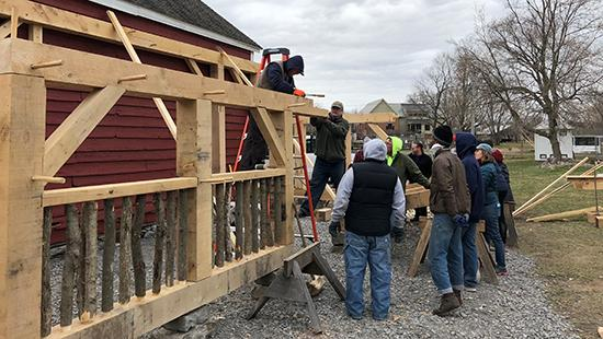 HPP Work Weekend participants build a structure for sheep at Mabee Farm in the Mohawk Valley