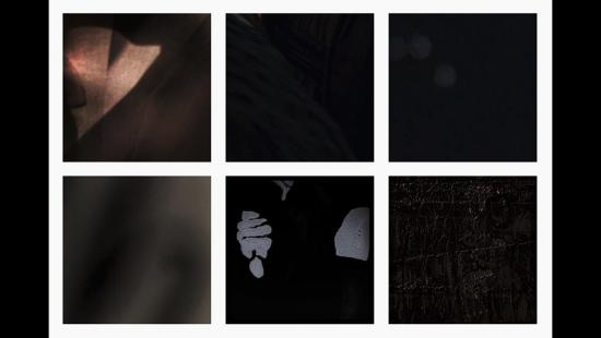 Eight dark rectangles, a downturned thumb, and dim shapes.