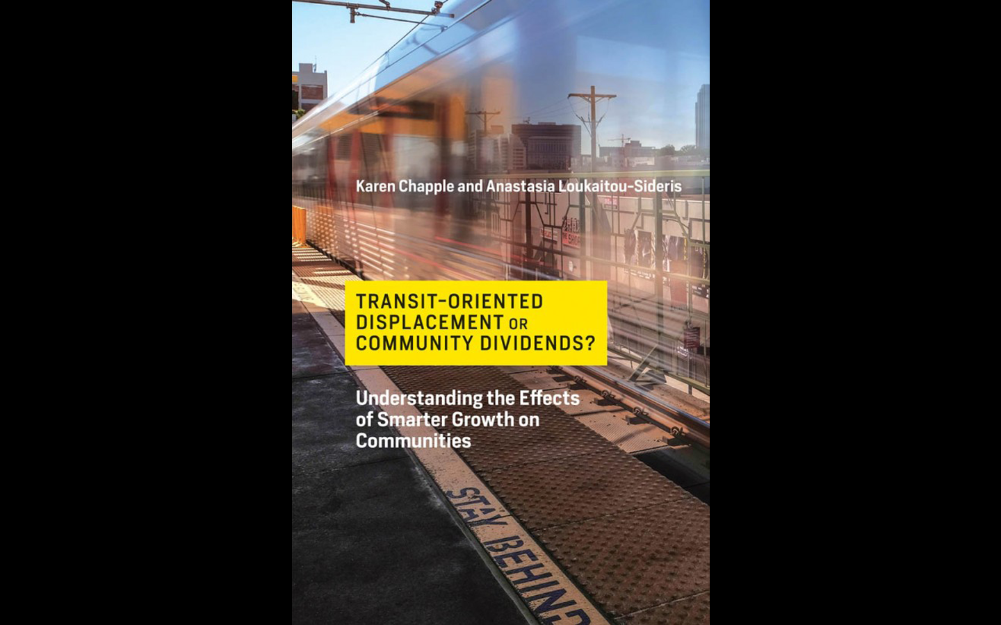 A translucent train passing through a station with a yellow rectangle and black text on the front.