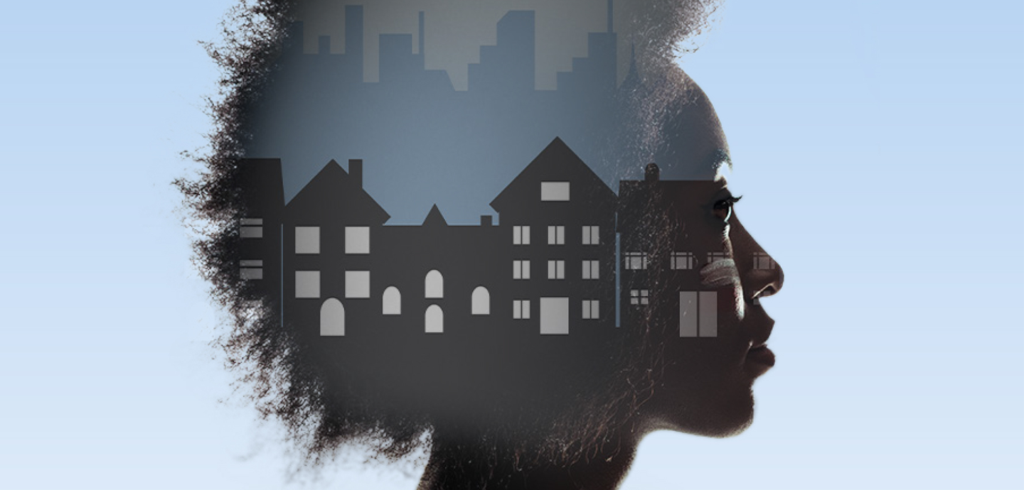 A person's head with houses and a city skyline within on a blue background.