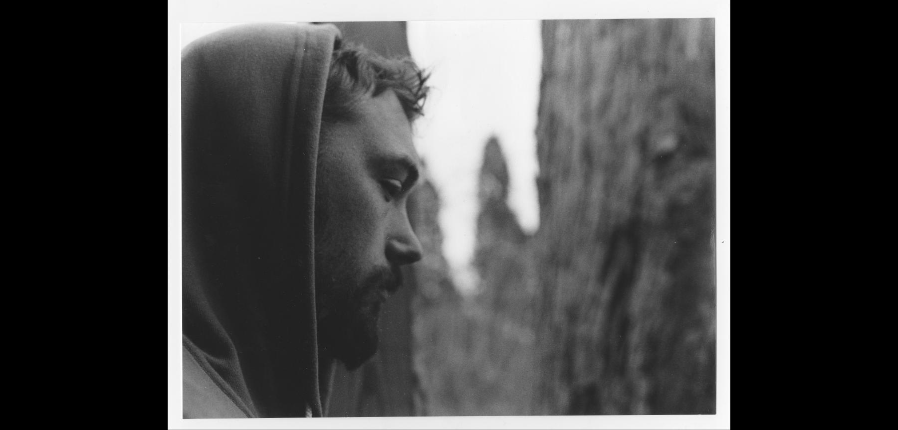black and white photograph profile of a person in a hoodie