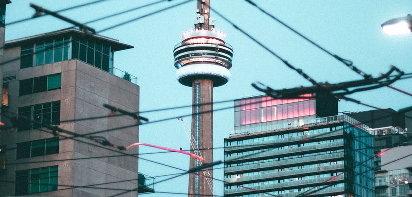 photo of observatory tower behind skyscrapers and electric wiring